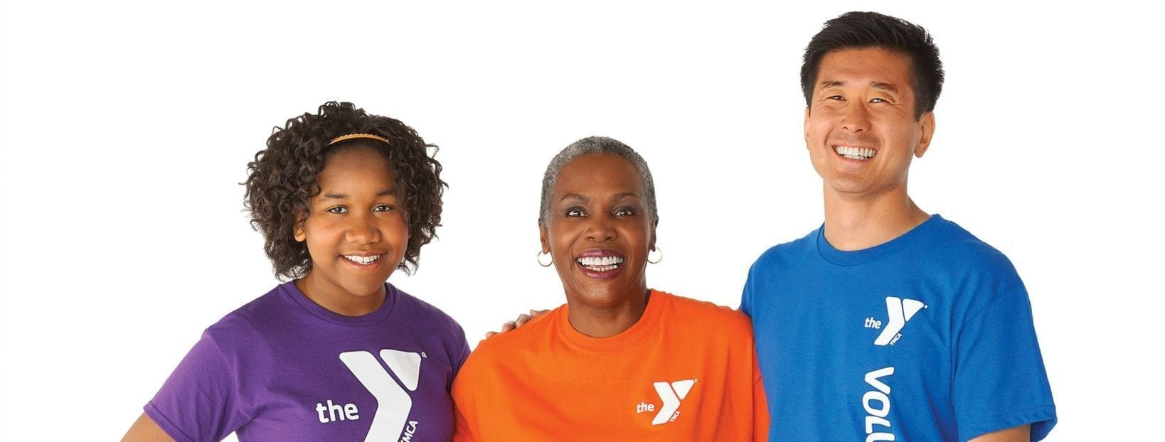 4 volunteers smiling in colorful shirts
