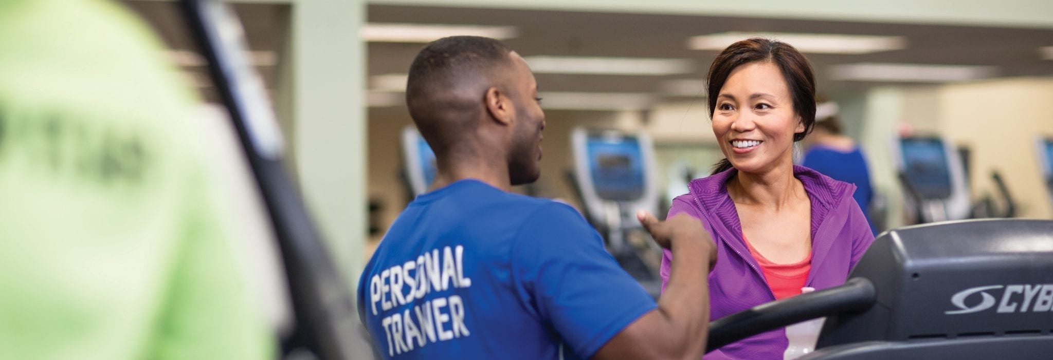 person trainer training woman on treadmill