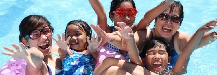 5 people smiling in pool