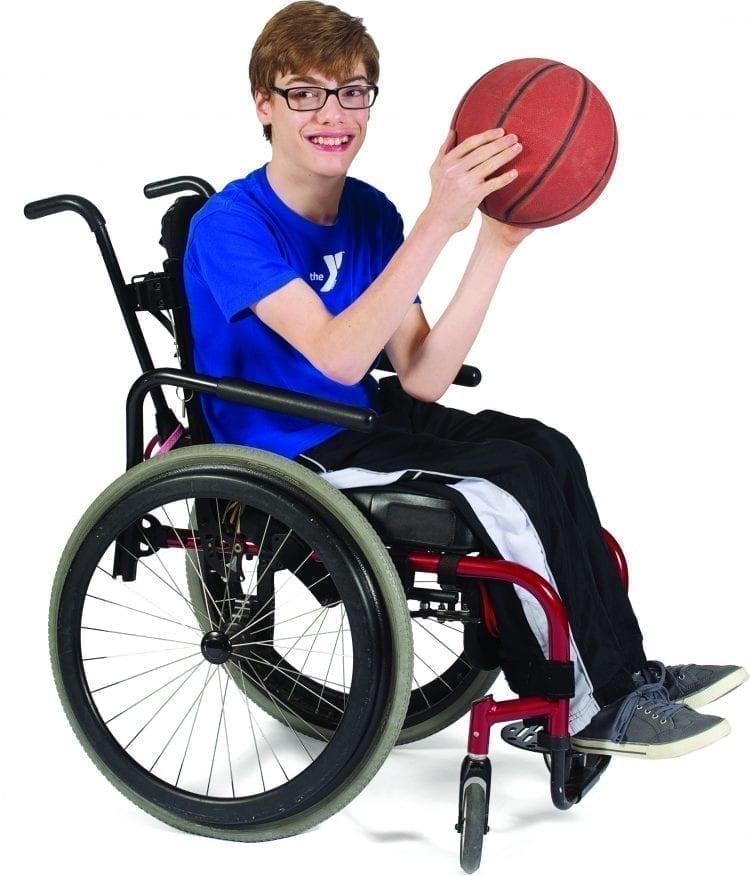 boy in wheelchair holding basketball